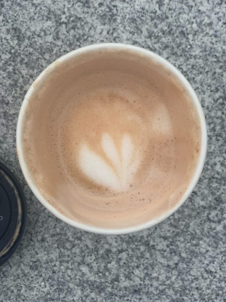 latte art in a blueberry latte from the independent cafe