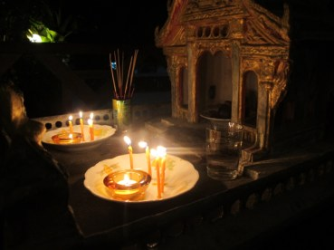 Our spirit house by candlelight.