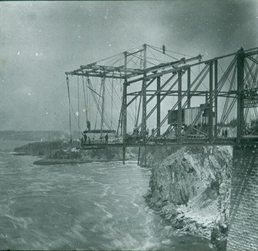 Construction of the Cantilever Bridge, Reversing Falls, Saint John, New Brunswick, c. 1885. Glass Lantern Slide, (8×10 cm). NB Museum Collection LS-AA188