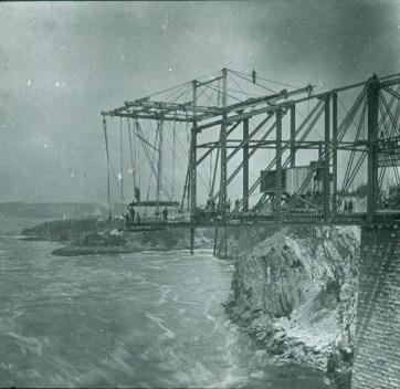 Construction of the Cantilever Bridge, Reversing Falls, Saint John, New Brunswick, c. 1885. Glass Lantern Slide, (8×10 cm). NB Museum Collection LS-AA188
