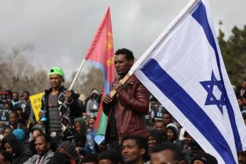 Eritrean refugees in Israel protest with Israeli and Eritrean flags