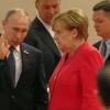 Angela Merkel voltéandole los ojos a Vladimir Putin durante la G20