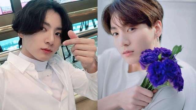 Jungkook haciendo corazón y con flores