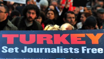 Turkish journalists hold placards against censorship during a protest on Istiklal Avenue in Istanbul, on March 13, 2011. Turkish police on March 3, detained about 10 people, mostly journalists, in a crackdown on an alleged secularist network accused of conspiring to topple the Islamic-rooted government. AFP PHOTO / MUSTAFA OZER