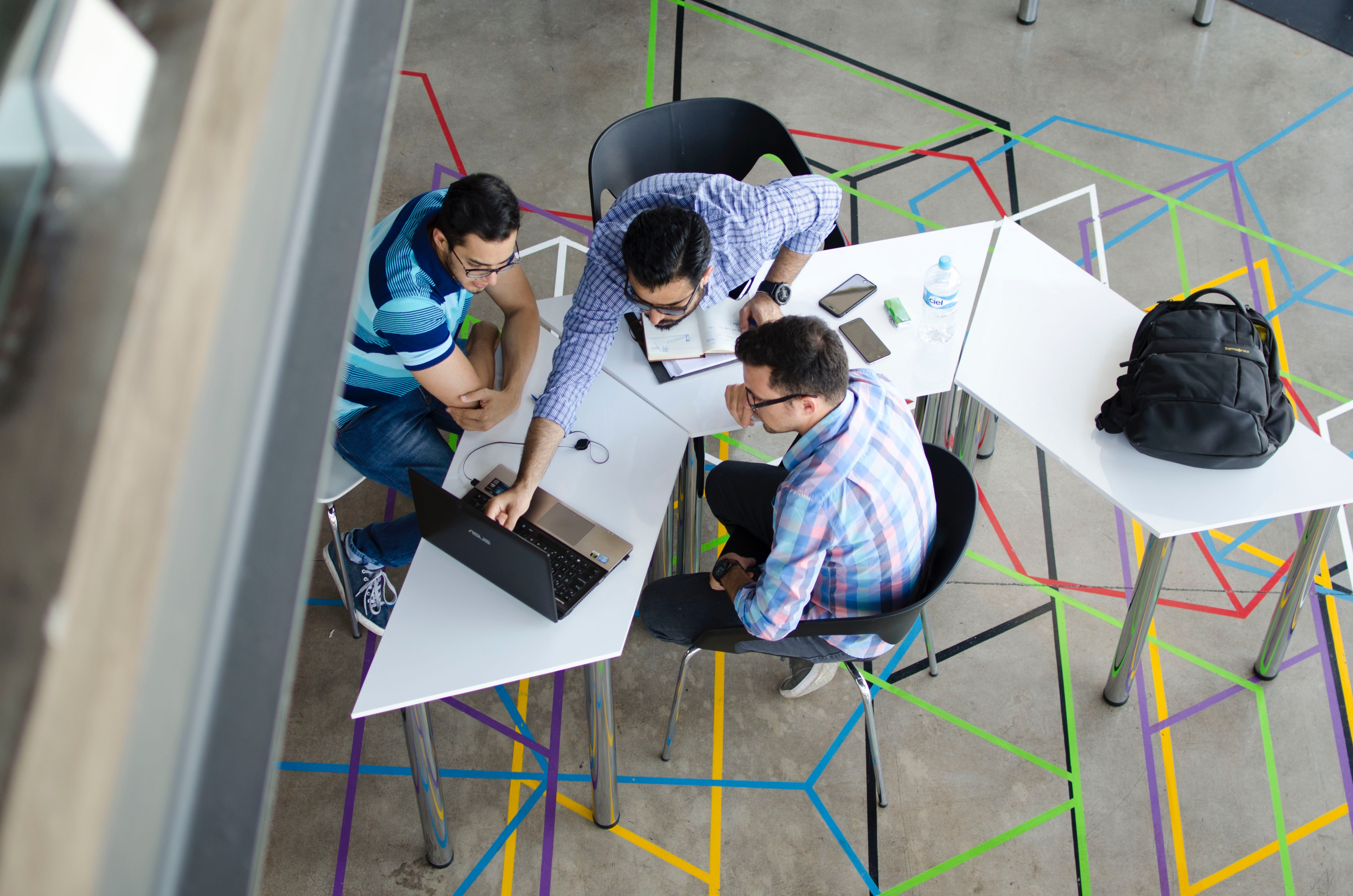 aerial view of a team working at a table