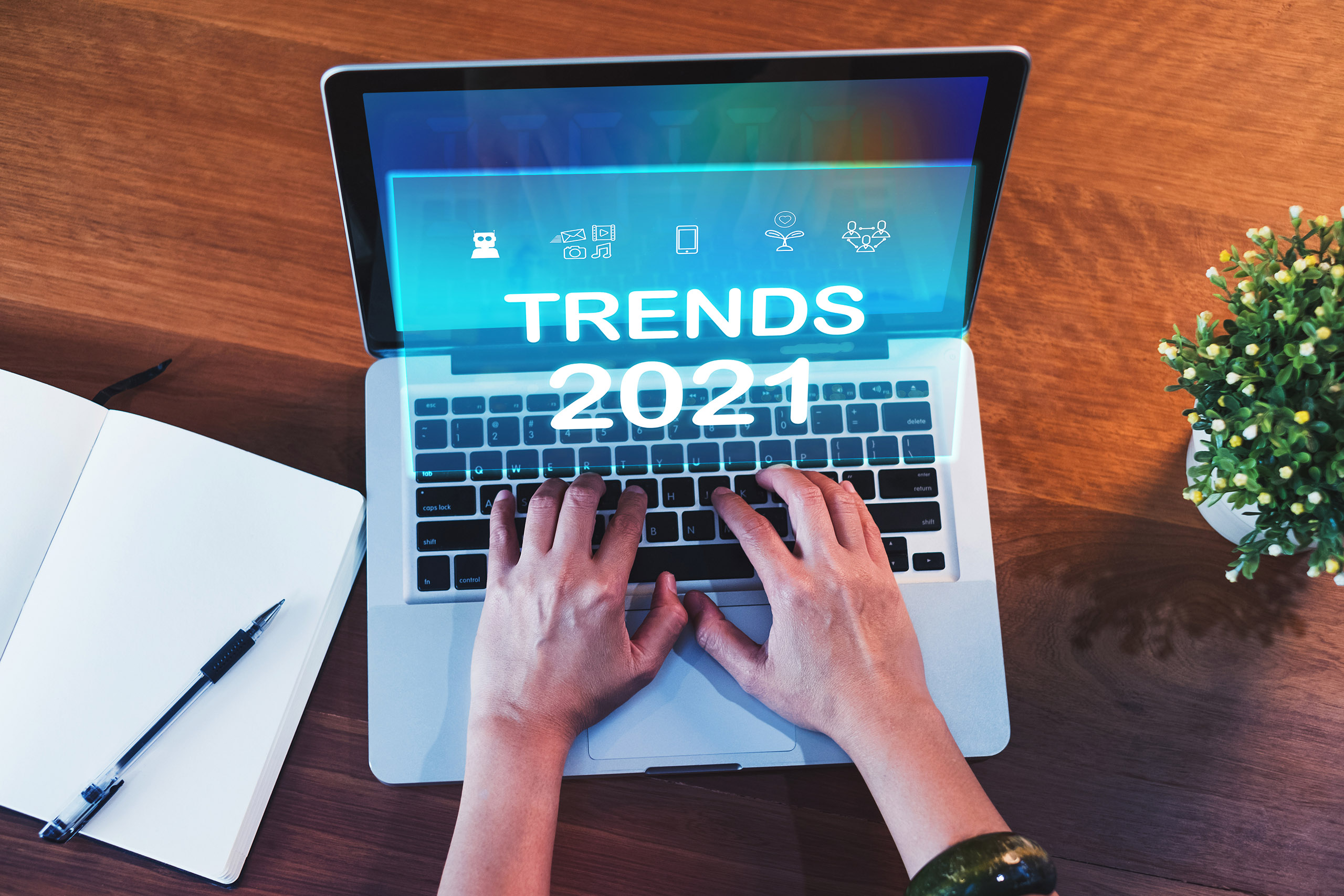 Laptop with someone typing that says trends 2021
