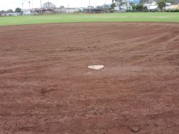 After the improvements were made at the field, there are no low lying areas for ponding. The field is now even which can be seen clearly on the field near homeplate.