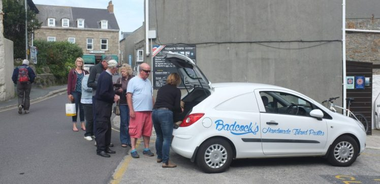 People queue for fresh Cornish pasties on the Isles of Scilly