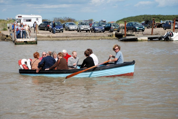 Man rows tourists across river on the Walberswick Ferry