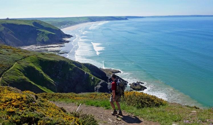 Man walks along the Pembrokeshire Coast Path