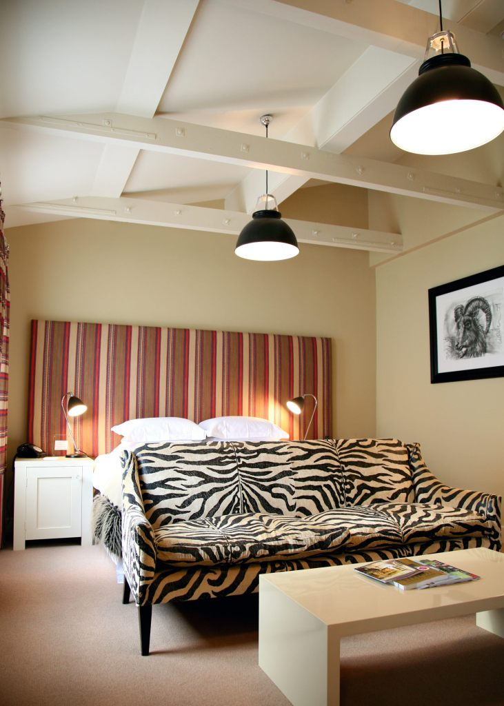 Bedroom at Kesgrave Hall with zebra print sofa