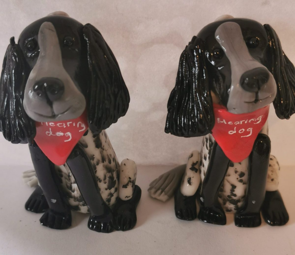 Clay hearing dogs with red bandanas