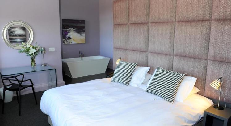 Stylish bedroom with freestanding bath at B+B Edinburgh