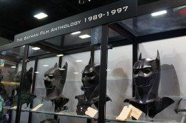 Batman masks in a display on the convention floor