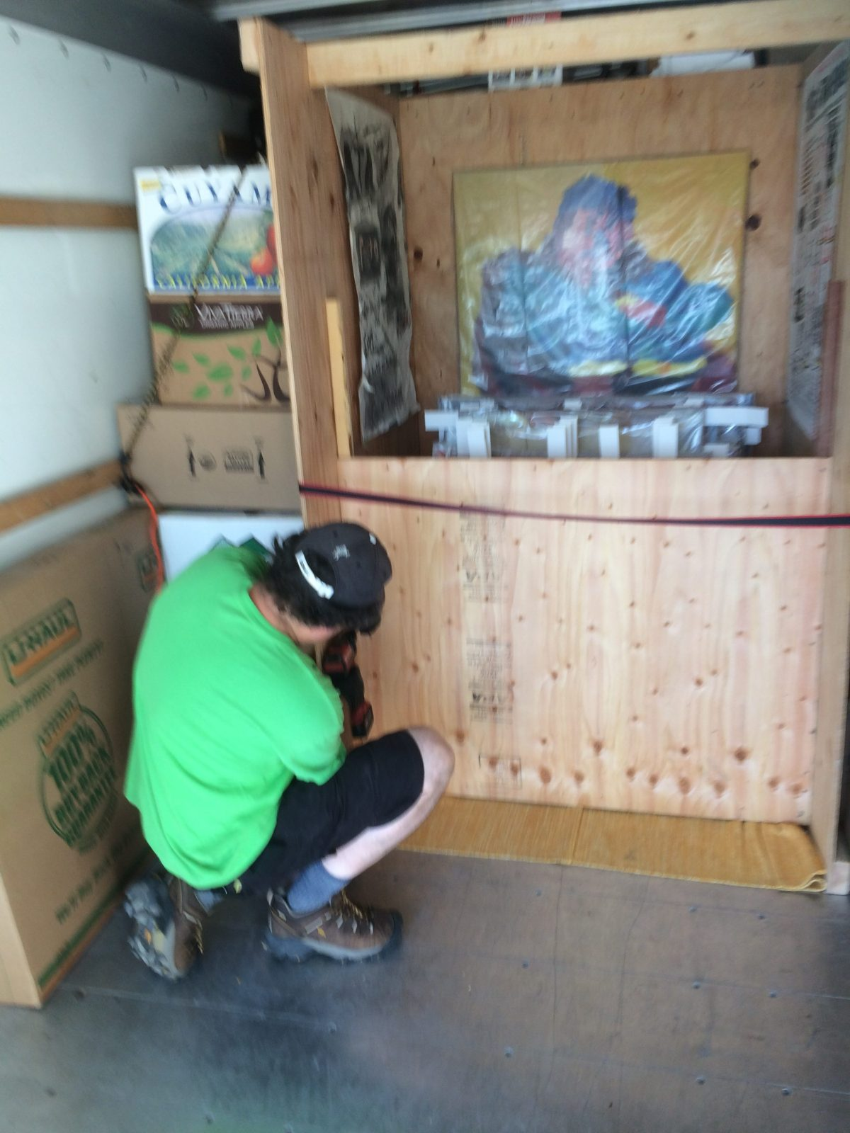 Alexi opening up the paintings' box