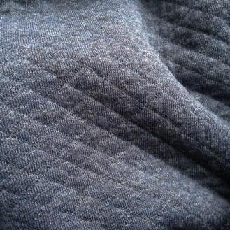 dunkelblau melierter Steppjersey aus Baumwolle und Polyester