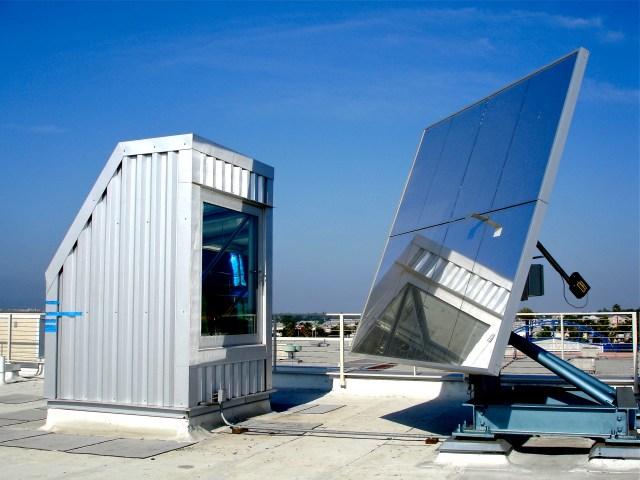 heliostat solar tracking mirror light into solar prism and rainbow light art installation. Erskine Solar Art