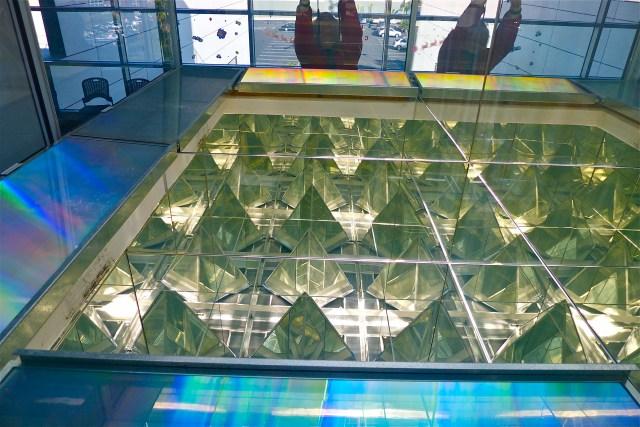 mirrors and flat prisms refract rainbow light in solar shaft. Erskine Solar Art
