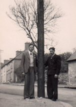 Tim and his colleague pose beside a recently erected pole