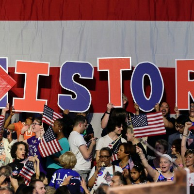 Supporters for Democratic presidential candidate Hillary Clinton hold up letters to spell the word, history, during a presidential primary election night rally, Tuesday, June 7, 2016, in New York.  (AP Photo/Julie Jacobson)