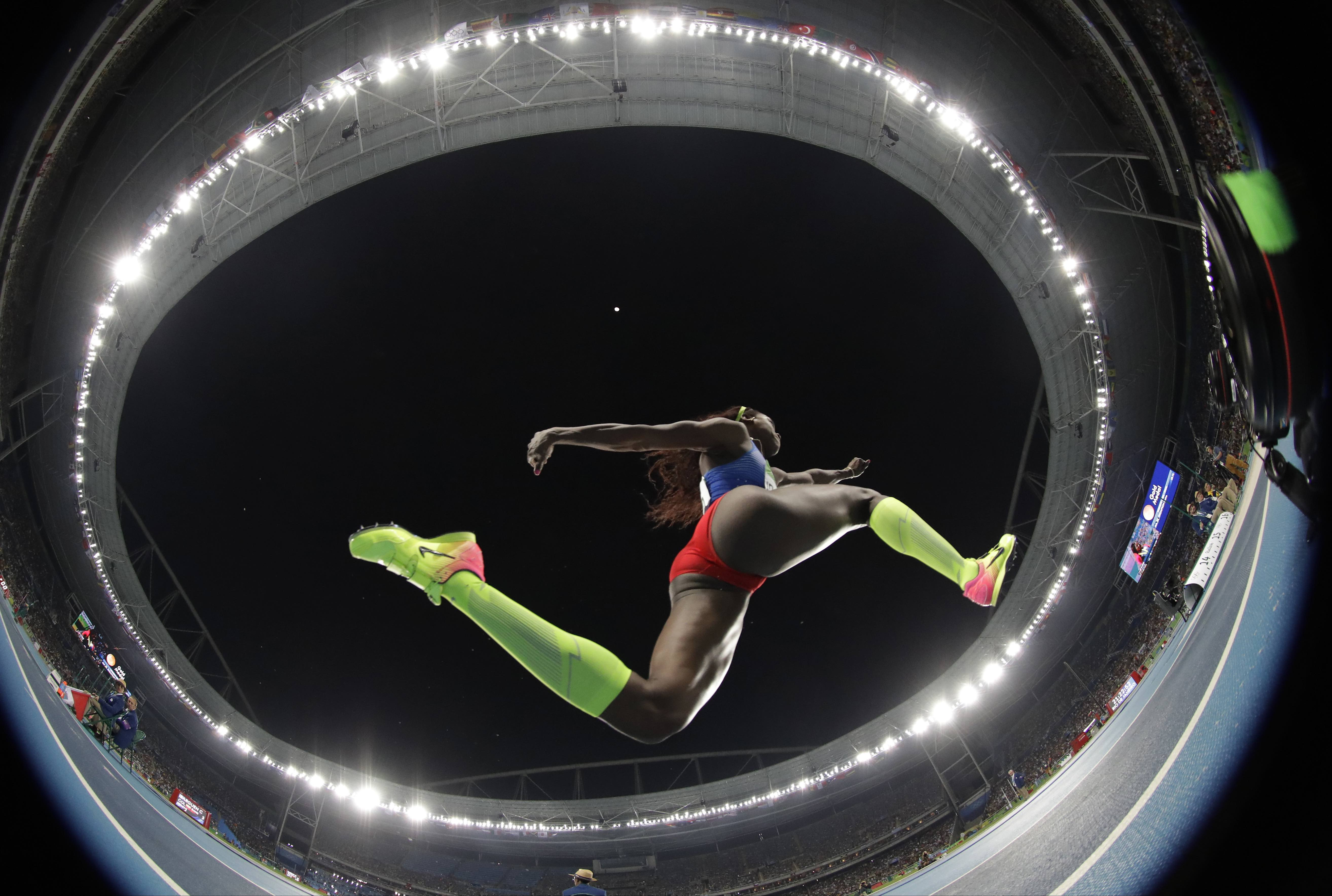 Colombia's gold medal winner Caterine Ibarguen makes an attempt in the women's triple jump final during the athletics competitions of the 2016 Summer Olympics at the Olympic stadium in Rio de Janeiro, Brazil, Sunday, Aug. 14, 2016. (AP Photo/Matt Dunham)