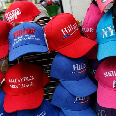 Hats displaying support for Republican presidential candidate Donald Trump and his Democratic opponent Hillary Clinton are displayed by a sidewalk vendor, Tuesday, Aug. 16, 2016, in New York. (AP Photo/Mark Lennihan)