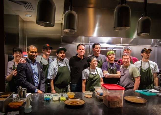 Celebrated chef Thomas Keller (center, in black) poses with FT33 staff after dinner at FT33 Friday night