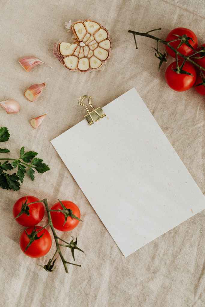 set of tasty fresh vegetables and herbs with empty clipboard