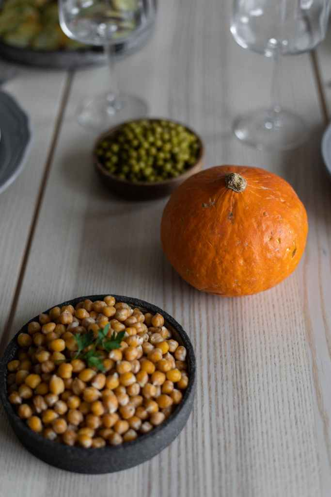 pumpkin and bowls with beans on table