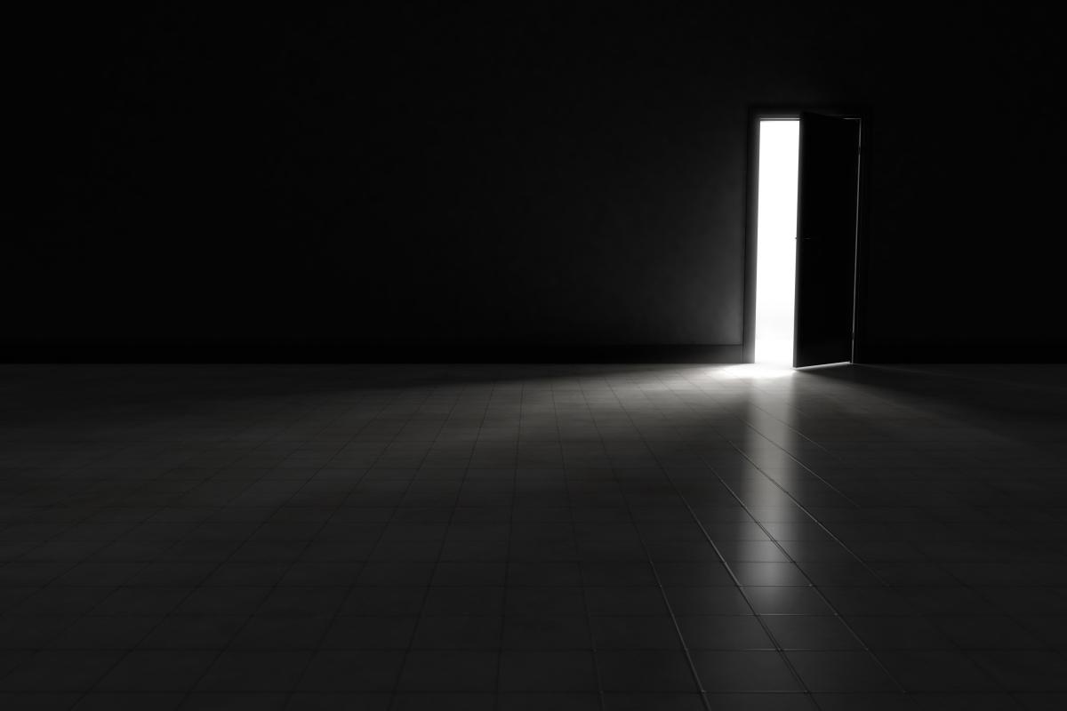dark room with light through door