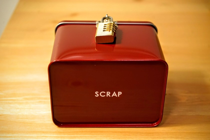 The red box that comes with the game is branded with SCRAP's logo!