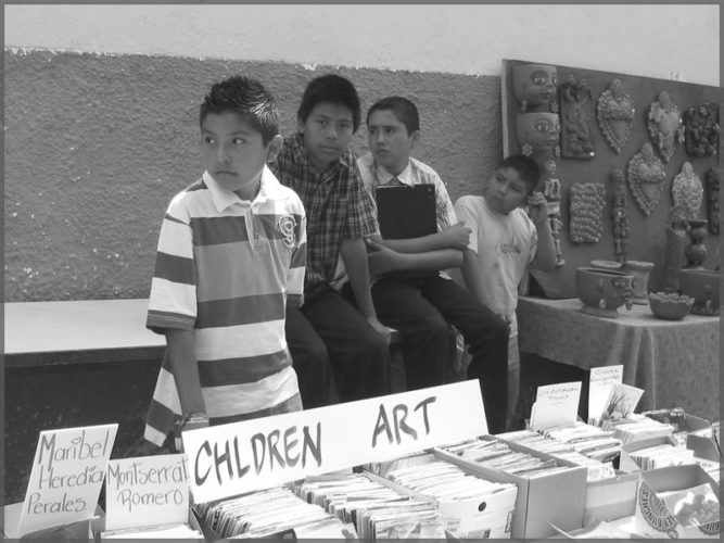 Ajijic peopleselling books at the art show in front of Efren Gonzalez studio in Ajijic.