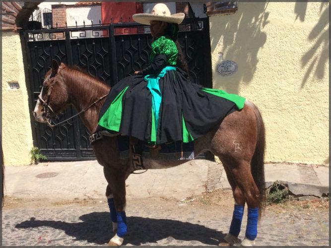 Girl on horse awaiting the Mardi Gras parade to start Carnival in Ajijic.