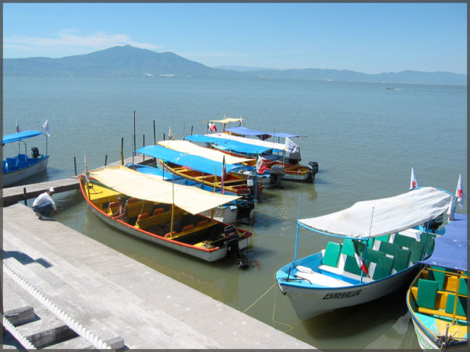 Water taxis at the pier in the town of Chapala on Lake Chapala.