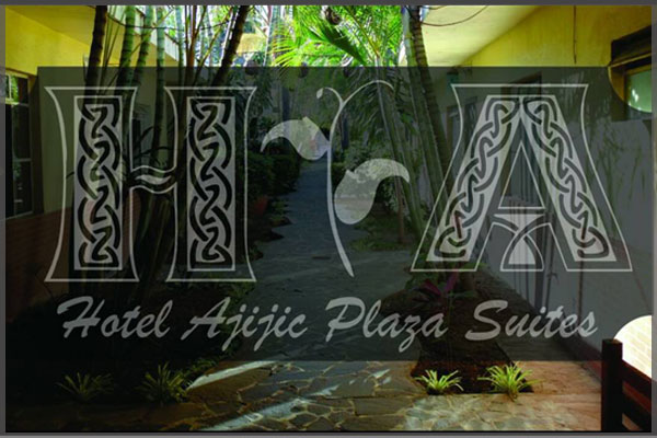 Logo and side garden area of Plaza Suites hotel.