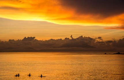 Standup Paddlers enjoying the sunset.