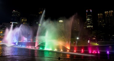 Fountains on the park side at night.