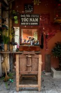 Reflections at the outdoor barber shop Hanoi