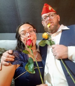 a man and a woman eating roses