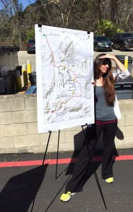 County Department of Planning and Land Use assistant with map of Lilac Hills Ranch displayed during planners tour this summer.