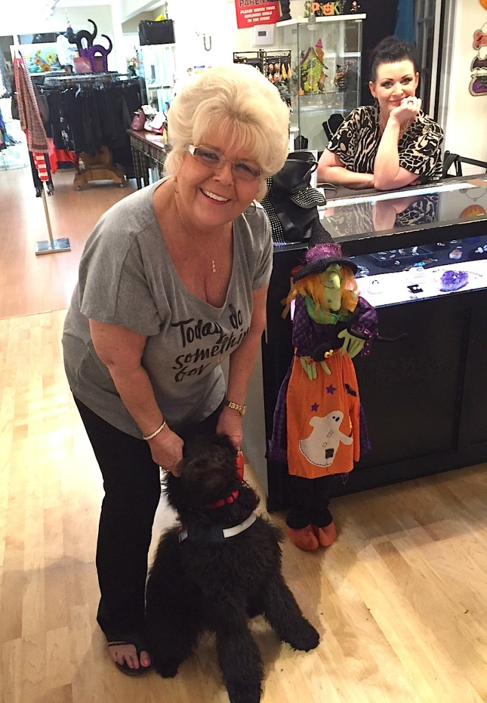 Cathy Ketchum, who owns HQ Wigs TOO, stops by Consignment4U with pet Dazzle to say hello daughter-in-law-to-be Crystal Hanson