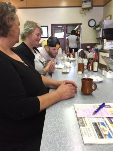 Grace Brouwer, forefront, an older Palomar College ceramics student, brought her daughter Miranda, a Grand Rapids, Michigan tattoo artist who was visiting, and her son John, who attends Palomar College to Champion's.