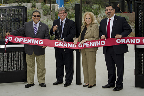 Shown ready to officially to cut the ribbon opening the new Baseball Field at Palomar College are, from left, Palomar College Governing Board members, Trustee John Halcón; President Mark Evilsizer; and Secretary Nancy Chadwick; along with Palomar College Interim Superintendent/President Adrian Gonzales.