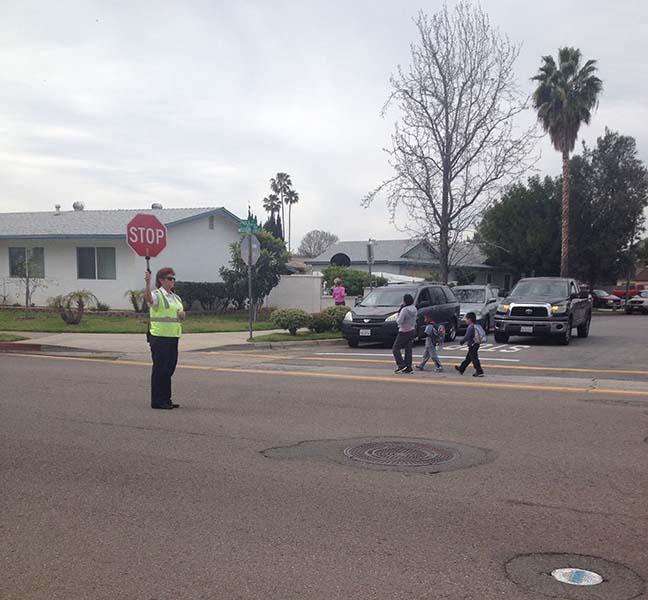 Crossing guard at Glen View Elementary School, 2201 E Mission Avenue.