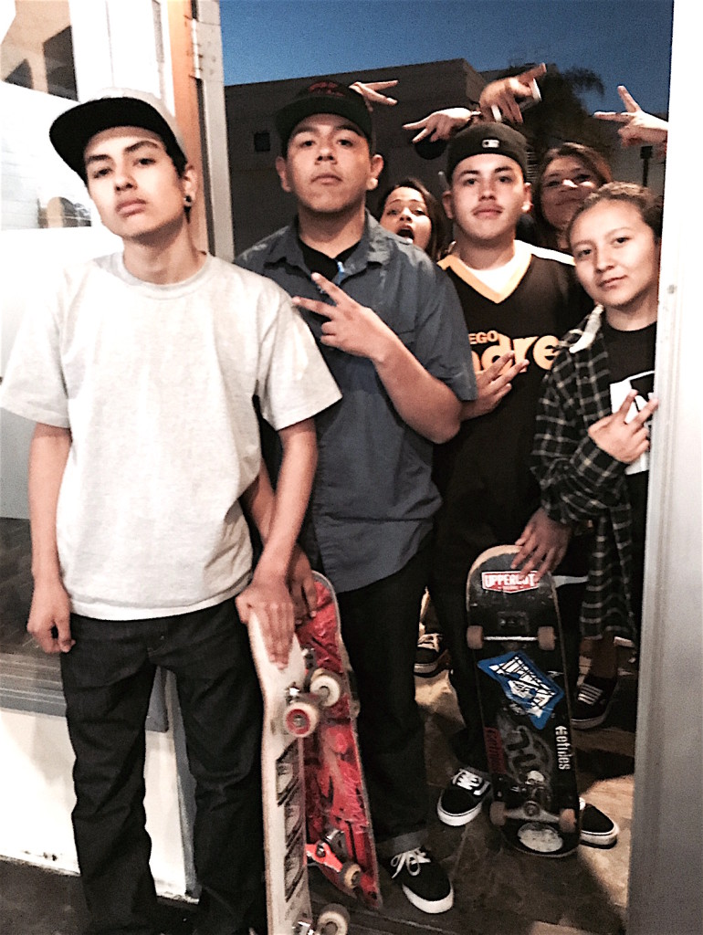 Escondido High School students (L-R) Noel Reyes, Bryan Aguirre, Richie Lopez, and Jasmine Solano arrived three hours early to meet underground rap star Self Provoked. (Photo: Shera Sandwell.)