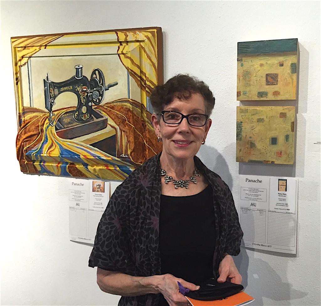 Artist Petey Dietz in the house, her work over her left shoulder.