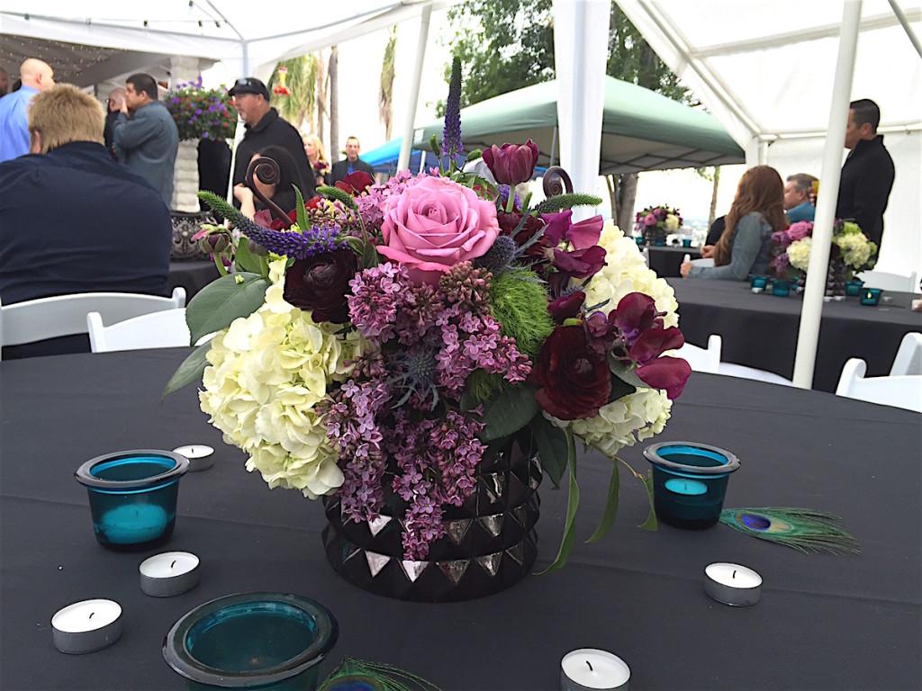 Floral arrangement amidst wedding party.