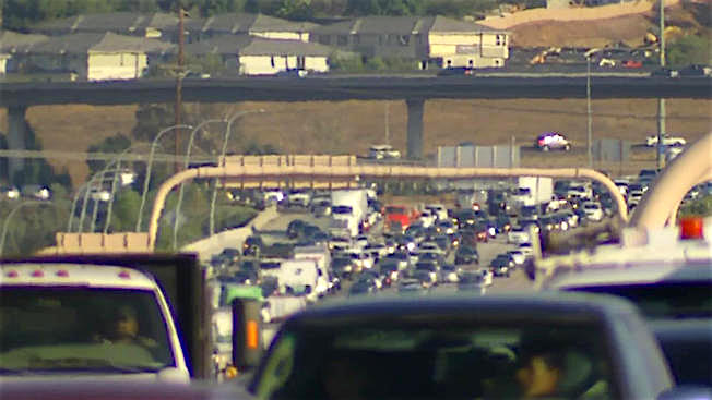 Front windshield view of Tuesday morning's I-15 traffic jam. (NBC-7 screen shot)