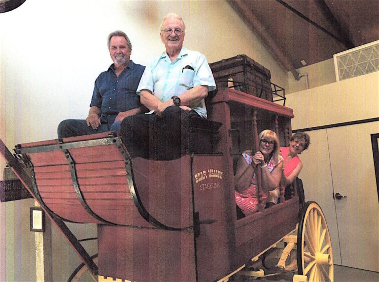 All aboard: officers of the Valley Center History Museum pose in the historic 1848 stagecoach which is the centerpiece of a new wing at the museum. Pictured are Earl Brown (top left). William Boyett, Nicky Lovejoy and Lynne Boyett.