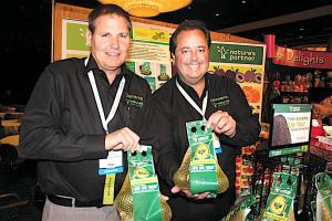 Giumarra Agricom International LLC salesman Joseph Casey (left) and director of marketing Gary Caloroso show off Giumarra's new avocado bags July 14 at the Fresh Produce & Floral Council's Southern California Expo in Anaheim. Photo by Tom Burfiled